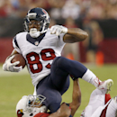 Houston Texans' Mike Thomas (89) gets tackled by Arizona Cardinals' Bryan McCann during the first half of an NFL preseason football game Saturday, Aug. 9, 2014, in Glendale, Ariz The Associated Press