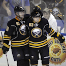 Buffalo Sabres Andre Benoit (61) celebrates a goal by Tyler Ennis (63) during the second period of an NHL hockey preseason game against the Carolina Hurricanes, Tuesday, Sept. 23, 2014, in Buffalo, N.Y. The Sabres beat the Hurricanes 2-0. The Associated P