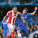 Chelsea's Frank Lampard, right, challenges Stoke City's Charlie Adam during their English Premier League soccer match between Chelsea and Stoke City at Stamford Bridge stadium in London, Saturday, April, 5, 2014