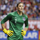 FILE - In this Oct. 20, 2013, file photo, United States goalkeeper Hope Solo pauses on the field during the second half of an international friendly women's soccer match against Australia in San Antonio. Goalkeeper Hope Solo has been suspended from the U.S. women's national team for 30 days, Wednesday, Jan. 21, 2015. The U.S. Soccer did not specify the reason for the suspension, announced Wednesday night. (AP Photo/Darren Abate, File)