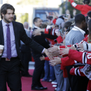 Chicago Blackhawks defenseman Brent Seabrook greets fans as he arrives at the United Center before an NHL hockey game against the Buffalo Sabres in Chicago, Saturday, Oct. 11, 2014 The Associated Press