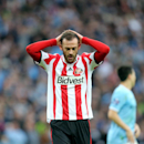 Sunderland's Steven Fletcher stands dejected after being defeated by Manchester City at the end of their English League Cup final soccer match at Wembley Stadium, London, England, Sunday, March 2, 2014
