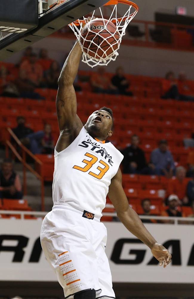 Oklahoma State guard Marcus Smart dunks against Emporia State in the first half of an NCAA college exhibition basketball game in Stillwater, Okla., Friday, Nov. 1, 2013