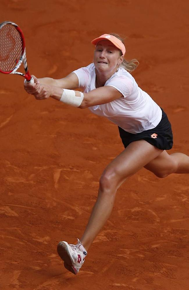 Ekaterina Makarova from Russia returns the ball during a Madrid Open tennis tournament match against Caroline Wozniacki from Denmark, in Madrid, Spain, Monday May 5, 2014