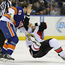 Ottawa Senators' Matt Kassian, right, falls to the ice during a fight with New York Islanders' Brett Gallant during the first period of an NHL hockey game Tuesday, April 8, 2014, in Uniondale, N.Y The Associated Press