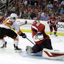 Philadelphia Flyers' Jason Akeson (42) scores a goal against Washington Capitals goalkeeper Justin Peters (35) as Washington Capitals' Liam O'Brien (87) defends during the second period of a NHL preseason hockey game, Thursday, Oct. 2, 2014, in Washington