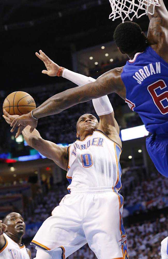 Oklahoma City Thunder guard Russell Westbrook (0) shoots in front of Los Angeles Clippers center DeAndre Jordan (6) in the second half of Game 5 of the Western Conference semifinal NBA basketball playoff series in Oklahoma City, Tuesday, May 13, 2014. Oklahoma City won 105-104. (AP Photo)