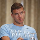 Manchester City Football Club striker Edin Dzeko listens to a reporter's question during a news conference in New York, Tuesday, July 29, 2014, in advance of Wednesday's Guinness International Champions Cup soccer match against rival Liverpool at Yankee S