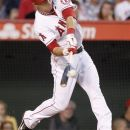 Los Angeles Angels' Mike Trout hits a home run against the New York Yankees during the fourth inning of a baseball game in Anaheim, Calif., Monday, May 28, 2012. (AP Photo/Chris Carlson)