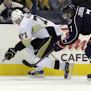Pittsburgh Penguins' Evgeni Malkin, left, of Russia, carries the puck up ice as Columbus Blue Jackets' Jack Johnson defends during the first period of an NHL hockey game Saturday, Dec. 13, 2014, in Columbus, Ohio The Associated Press