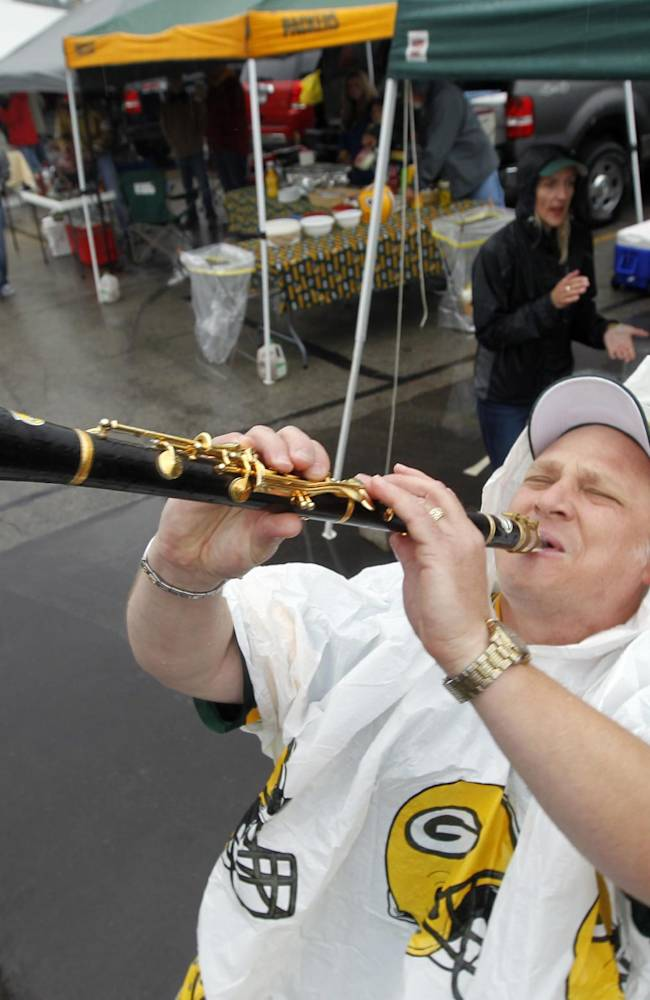 Kevin Van Ness plays a clarinet before an NFL football game between the Green Bay Packers and the Washington Redskins Sunday, Sept. 15, 2013, in Green Bay, Wis