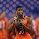 Florida State quarterback Jameis Winston runs a drill at the NFL football scouting combine in Indianapolis, Saturday, Feb. 21, 2015. (AP Photo/Julio Cortez)