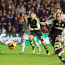 Stoke City s Charlie Adam , right, scores his side s third goal from the penalty spot during their English Premier League soccer match against Swansea City at the Liberty Stadium, Swansea, Wales, Sunday, Nov. 10, 2013