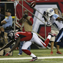 Atlanta Falcons wide receiver Julio Jones (11) heads to the turf as Tennessee Titans defensive back Tommie Campbell (37) looks on during the first half of an NFL preseason football game, Saturday, Aug. 23, 2014, in Atlanta The Associated Press