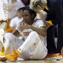 FILE - In this Jan. 23, 2014, file photo, Tennessee guard Ariel Massengale (5) is assisted by head coach Holly Warlick after getting injured in the first half of an NCAA college basketball game in Knoxville, Tenn. Massengale missed the final 16 games of the 2013-14 season because of a head injury. (AP Photo/Wade Payne, File)