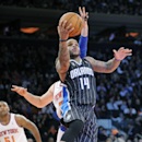 Orlando Magic guard Jameer Nelson (14) puts up a shot as he gets by New York Knicks' Andrea Bargnani during the fourth quarter of an NBA basketball game Friday, Dec. 6, 2013, at Madison Square Garden in New York. The Knicks won 121-83 The Associated Press