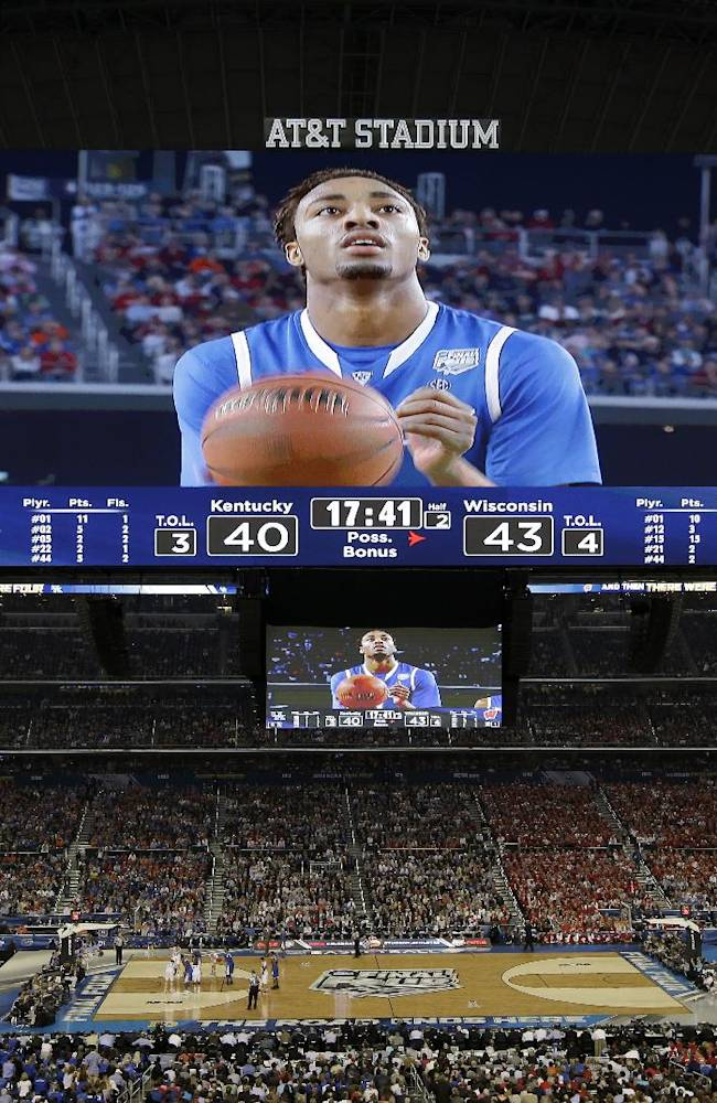 Kentucky guard James Young  takes a foul shot against Wisconsin during the second half of the NCAA Final Four tournament college basketball semifinal game Saturday, April 5, 2014, in Arlington, Texas