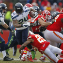 Seattle Seahawks running back Marshawn Lynch (24) is tackled by Kansas City Chiefs strong safety Eric Berry (29) in the first half of an NFL football game in Kansas City, Mo., Sunday, Nov. 16, 2014 The Associated Press