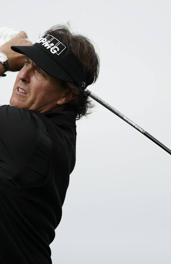 Phil Mickelson watches his tee shot on the second hole of the South Course during the second round of the Farmers Insurance Open golf tournament Friday, Jan. 24, 2014, in San Diego
