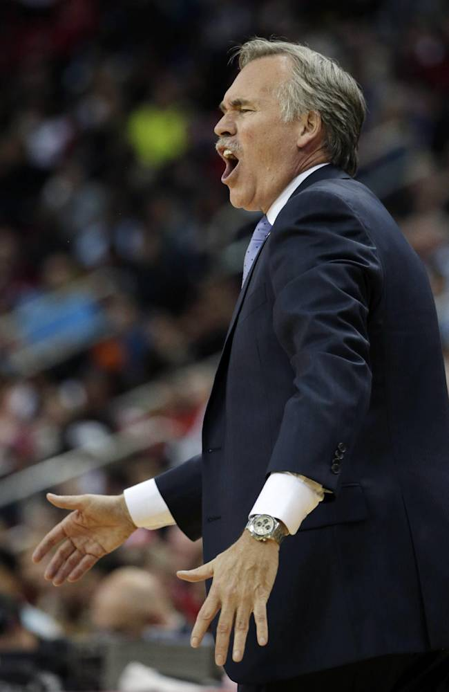 Los Angeles Lakers coach Mike D'Antoni reacts to a call during the second quarter of an NBA basketball game against the Houston Rockets Thursday, Nov. 7, 2013, in Houston