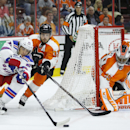 New York Rangers' Carl Hagelin, left, of Sweden, tries to get a shot past Philadelphia Flyers' Mark Streit, center, of Switzerland, and Ray Emery during the first period of a preseason NHL hockey game, Tuesday, Sept. 30, 2014, in Philadelphia The Associat