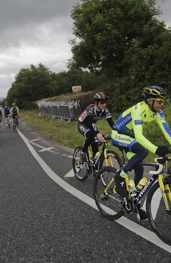 Spain's Alberto Contador, second right, rides with a teammate during a training ahead of the Tour de France cycling race in Leeds, Britain, Thursday, July 3, 2014. The Tour de France will start on Saturday July 5 in Leeds, and finishes in Paris on Sunday July 27