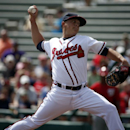 Atlanta Braves starting pitcher Kris Medlen (54) throws in a spring exhibition baseball game against the Washington Nationals, Tuesday, March 4, 2014, in Kissimmee, Fla The Associated Press