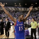 Kansas guard Elijah Johnson celebrates after an NCAA college basketball game against Kansas State on Tuesday, Jan. 22, 2013, in Manhattan, Kan. Kansas won 59-55. (AP Photo/Charlie Riedel)