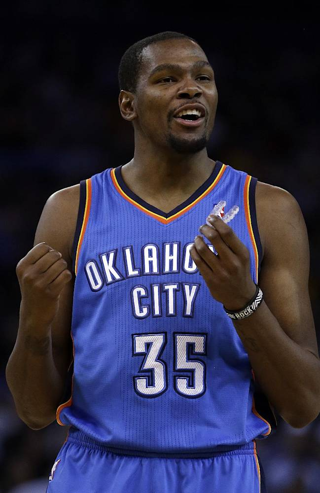 Oklahoma City Thunder's Kevin Durant reacts after scoring against the Golden State Warriors during the first half of an NBA basketball game Thursday, Nov. 14, 2013, in Oakland, Calif