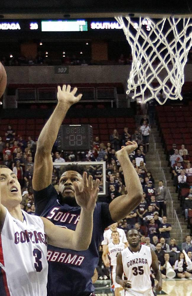 Gonzaga's Kyle Dranginis, left, shoots against the defense of South Alabama's Isaiah Maston, right, in the first half of an NCAA college basketball game, Saturday, Dec. 14, 2013, in Seattle