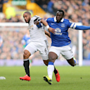 Swansea City's Ashley Williams, left, and Everton's Romelu Lukaku battle for the ball during their English Premier League soccer match at Goodison Park, Liverpool, England, Saturday, March 22, 2014