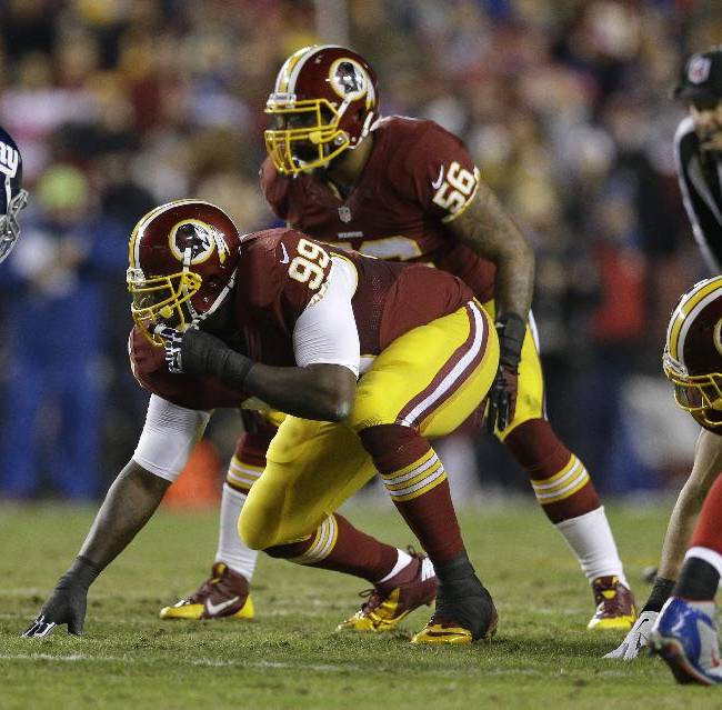 Washington Redskins defensive end Jarvis Jenkins (99) and inside linebacker Perry Riley (56) line up for a play during the first half of an NFL football game against the New York Giants, Sunday, Dec. 1, 2013, in Landover, Md