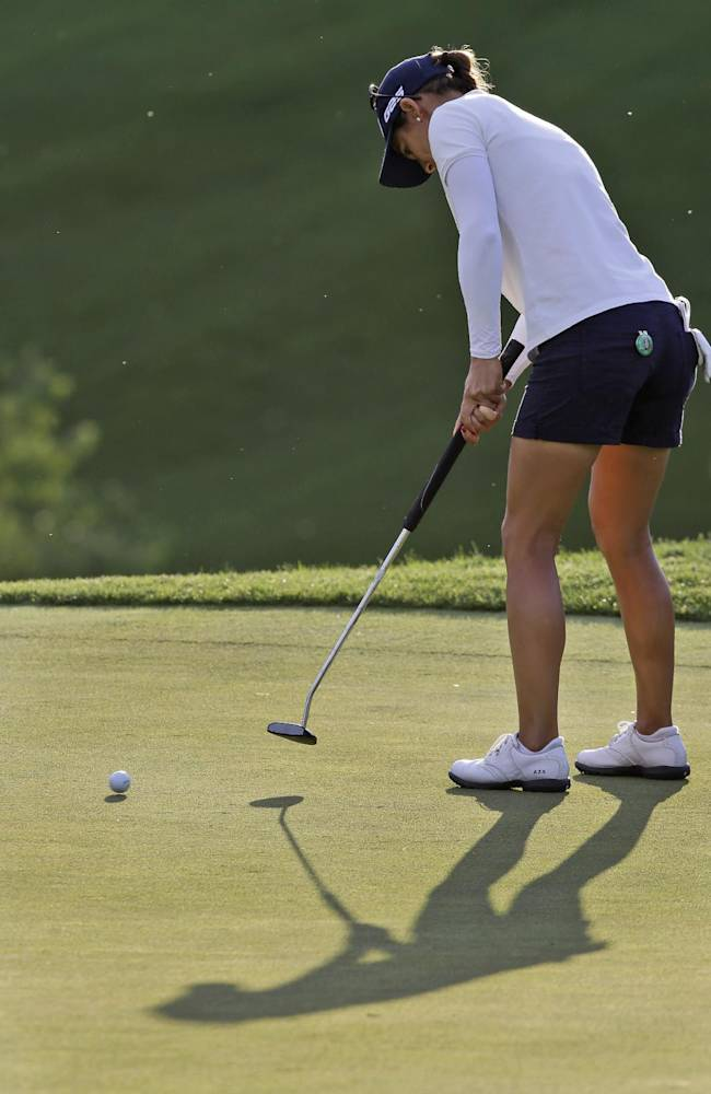 Azahara Munoz, of Spain, putts on the ninth green during the rain delayed second round of the Kingsmill Championship golf tournament at the Kingsmill resort  in Williamsburg, Va., Friday, May 16, 2014