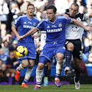 Chelsea's Frank Lampard, foreground, controls the ball in front of Everton's Leon Osman, right, during an English Premier League soccer match at the Stamford Bridge ground in London, Saturday, Feb. 22, 2014. Chelsea won the match 1-0