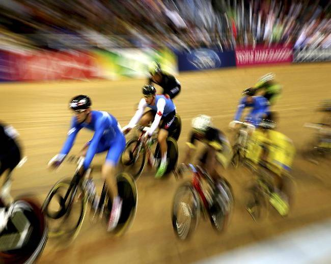 Cyclists compete in the Men's 40km qualifying points race at the Chris Hoy velodrome at the Commonwealth Games Glasgow 2014, Scotland, Saturday July 26, 2014