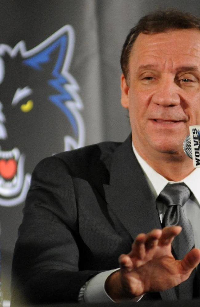 In this May 3, 2013, file photo, former Minnesota Timberwolves head coach Flip Saunders is introduced as the Timberwolves' new president for basketball operations during an NBA basketball news conference in Minneapolis. Saunders' presence is often felt before it is heard. He likes to sneak up behind player, employees, media and put a firm grip on a shoulder