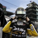 Josef Newgarden dons his helmet as he prepares to drive during practice for the Indianapolis 500 auto race at the Indianapolis Motor Speedway in Indianapolis, Thursday, May 16, 2013. (AP Photo/Darron Cummings)