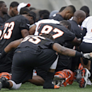 Cincinnati Bengals linebacker Vontaze Burflict (55) holds hands at the close of the NFL football team's mandatory minicamp, Thursday, June 13, 2013, in Cincinnati.  (AP Photo/Al Behrman)