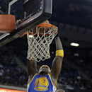 Golden State Warriors center Jermaine O'Neal, left, goes for a shot over Sacramento Kings forward Chuck Hayes during the first quarter of an NBA basketball game in Sacramento, Calif., Sunday, Dec. 1, 2013. (AP Photo/Rich Pedroncelli)