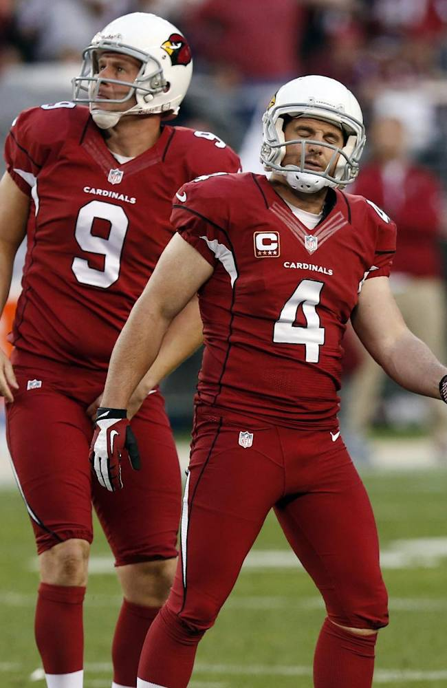 Arizona Cardinals kicker Jay Feely (4) stands on the field after he missed a field goal while teammate Dave Zastudil (9) is near during the second half of an NFL football game against the San Francisco 49ers, Sunday, Dec. 29, 2013, in Glendale, Ariz. The 49ers won 23-20