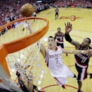 Houston Rockets' Jeremy Lin (7) shoots past Portland Trail Blazers' LaMarcus Aldridge (12) during the first half in Game 1 of an opening-round NBA basketball playoff series, Sunday, April 20, 2014, in Houston The Associated Press