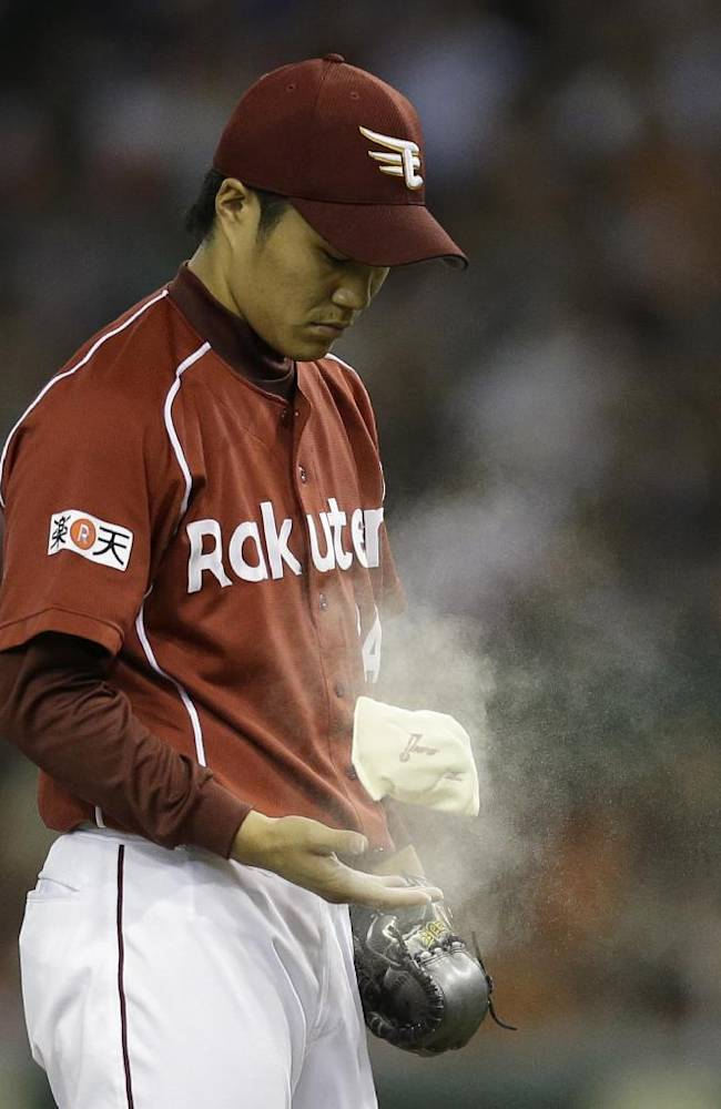 Rakuten Eagles closer Takahiro Norimoto juggles a rosin bag on the mound in the ninth inning of Game 5 of baseball's Japan Series against the Yomiuri Giants at Tokyo Dome in Tokyo, Thursday, Oct. 31, 2013