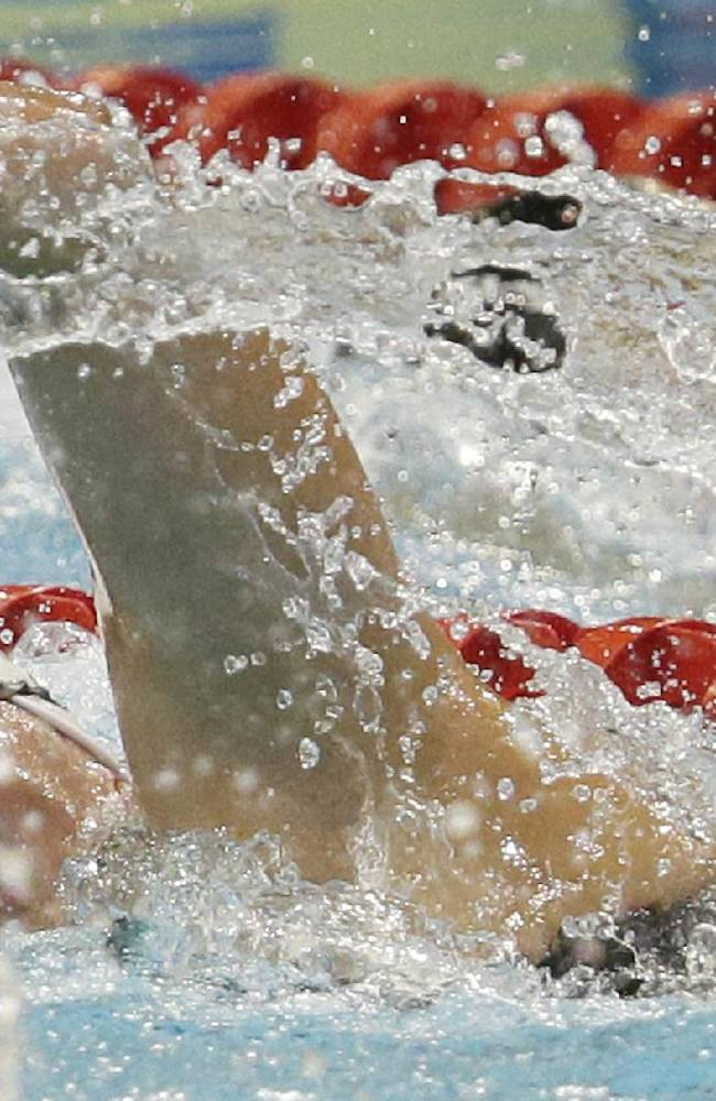 Denmark's Lotte Friis competes in a women's 800m freestyle first round heat at the LEN Swimming European Championships in Berlin, Germany, Wednesday, Aug. 20, 2014