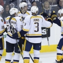 Nashville Predators' James Neal (18), Anton Volchenkov (20), Filip Forsberg (9), Seth Jones (3) and Mike Ribeiro (63) celebrate Neal's goal against the Winnipeg Jets during the third period of an NHL hockey game Friday, Oct. 17, 2014, in Winnipeg, Manitob