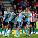 West Ham United's Stewart Downing, center, celebrates his goal with bhis teammates during their English Premier League soccer match against Sunderland at the Stadium of Light, Sunderland, England, Saturday, Dec. 13, 2014