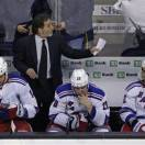 New York Rangers head coach John Tortorella, top, calls to his players late in the third period while facing the Boston Bruins in Game 5 of the Eastern Conference semifinals in the NHL hockey Stanley Cup playoffs in Boston, Saturday, May 25, 2013. (AP Photo/Charles Krupa)