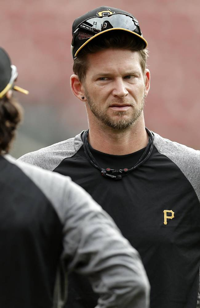 Pittsburgh Pirates pitcher A.J. Burnett, right, talks with a teammate during a workout on Wednesday, Oct. 2, 2013, in St. Louis. Burnett is scheduled to be the starting pitcher for the Pirates against the St. Louis Cardinals in Game 1 of the National League Division Series baseball playoff on Thursday