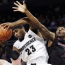 Providence forward LaDontae Henton (23) brings down a rebound against Cincinnati forward Titus Rubles (2) during the first half of an NCAA college basketball game in Providence, R.I., Wednesday, Feb. 6, 2013. (AP Photo/Elise Amendola)