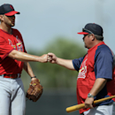 St. Louis Cardinals pitcher Adam Wainwright, left, gets a fist bump from pitching coach Derek Lilliquist after throwing live batting practice during spring training baseball Friday, Feb. 21, 2014, in Jupiter, Fla The Associated Press