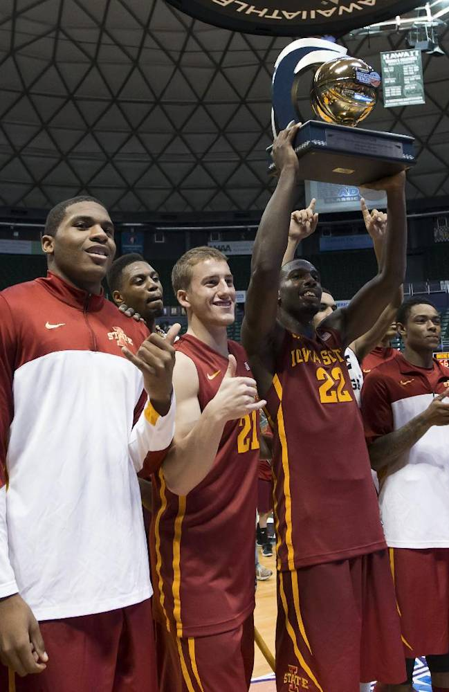 The Iowa State basketball team shows off the Diamond Head Classic championship trophy to their fans after defeating Boise State 70-66 in an NCAA college basketball game Wednesday, Dec. 25, 2013, in Honolulu